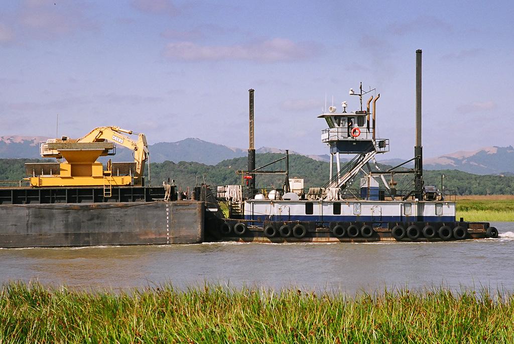 tug and barge on Petaluma river